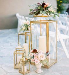 Gold lanterns with flowers and candles for the wedding isle. Lantern Centerpiece Wedding, Wedding Lanterns, Wedding Ceremony Decorations, Wedding Centerpieces, Wedding Table, Wedding Receptions, Centerpiece Ideas, Gold Lanterns, Gold Candles