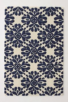 I love this rug from Anthropologie, comes in blue, red, cream and green
