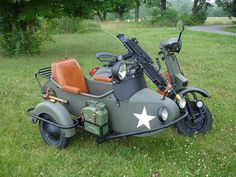 I want!!   Military Vespa sidecar