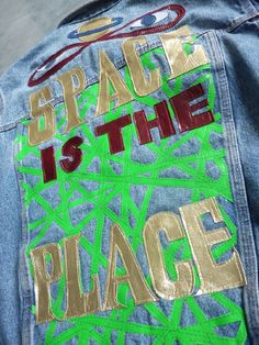 """Denim jacket's back """"Space is the place"""" by Camille Lavaud"""