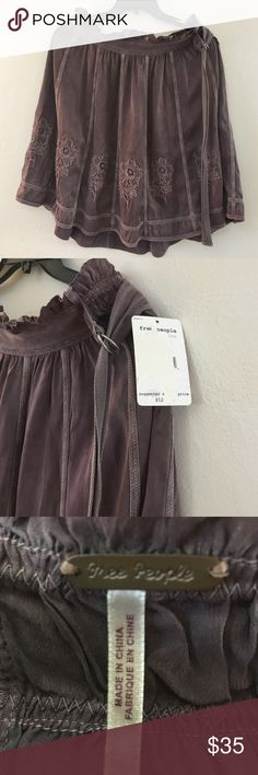 NWT Free People Brown Silk Skirt😍 NWT Great 🎁 for Christmas 🎄Free People 💯 Silk Brown Flowing Skirt with embroidered flowers in the front, very soft😍 Free People Skirts Midi