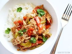 Chicken slowly stewed with tomatoes, peppers, onions, and spices makes this Slow Cooker Chicken Ropa Vieja a versatile favorite. Step by step photos.