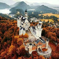 Neuschwanstein Castle is a nineteenth-century Romanesque Revival palace on a rugged hill.