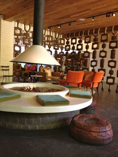 taking the idea on indoor fire-pit and style of the room divider for my earthship