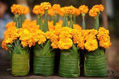 Banana Leaf & Flower Sculptures Biodegradable flower arrangement – marigolds in banana leaf vases! Wedding Stage Decorations, Festival Decorations, Flower Decorations, Marigold Flower, Marigold Wedding, Leaf Flowers, Floral Arrangements, Flower Arrangement, Banana Leaves