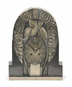 AN ART DECO PATINATED-METAL MANTEL CLOCK, EARLY 20TH CENTURY, SIGNED 'R. TERRAS'