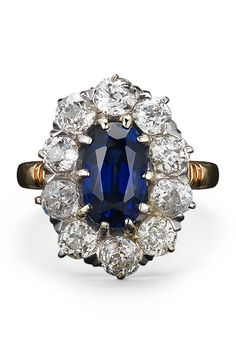Fred Leighton 19th Century Oval Sapphire and Diamond Cluster Ring, price upon request; call 212.288.1872   - ELLE.com