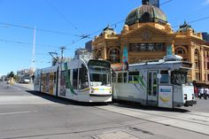 Two Melbourne trams passing Flinders Street Station in Swanston Street, 2013.
