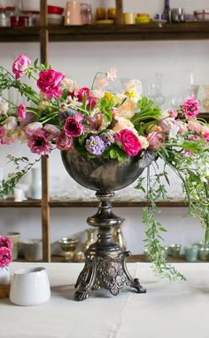 Display your grandiose floral arrangements in style with this large Pedestal Bowl. This piece stands tall and will beautifully elevate centerpieces on your reception tables. The bowl has an antique silver look and features intricate detail around Beautiful Flower Arrangements, Wedding Table Centerpieces, Wedding Flower Arrangements, Flower Centerpieces, Flower Vases, Floral Arrangements, Beautiful Flowers, Wedding Flowers, Wedding Decorations