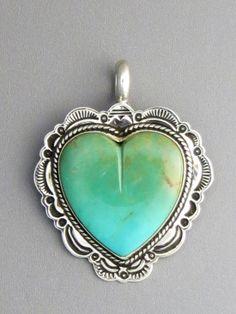 Kingman Turquoise Heart Pendant Reversible by Elgin Tom - Native American Heart Pendant http://www.southwestsilvergallery.com/AWSCategories/p/412/Heart-Pendants