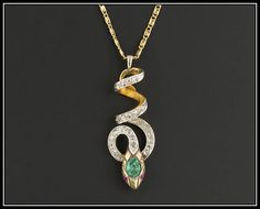 An outstanding diamond snake pendant created from an antique pin (circa 1890-1915). This gorgeous pendant features 24 rose cut diamonds, ruby eyes, and a green glass accent on its head. The pendant is 14k gold (unmarked, but acid tested) and weighs 6.0 grams. The piece measures 1.5 inches from the top of the bale to the bottom of the pendant by 0.5 inches wide. It is in very good condition. We are providing the option to purchase the pendant with or without the 18 inch 14k gold chain…