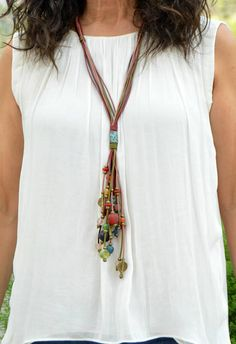 Multi leather necklace in various colors, colored glass beads recycled by African artisans, African vintage brass pins, metal tube and metal beads. Ethnic and tribal jewelry. Ideal as a engagement gift or on different occasions, Valentines Day, Christmas, Mothers Day, birthday. (The