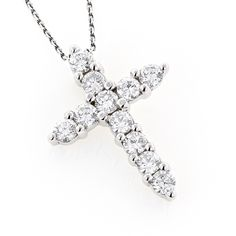 A cross necklace similar to this that will last forever and at least a 1 inch pendant.   Luxurman 14k Gold 1ct TDW Round Diamond Cross Pendant (G-H, VS1-VS2)
