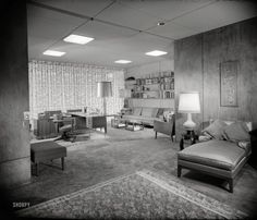 """1956. """"Hayes residence, Kessler Lake Drive, Dallas. Bedroom to adjoining office."""" Our third look at car dealer Earl Hayes' contemporary cottage. Photo by Maynard L. Parker for House Beautiful. Source: Huntington Library."""
