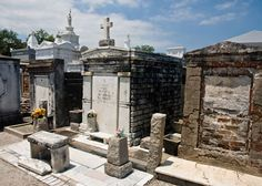 St Louis Cemetery No 1. The 18th century above ground cemeteries of New Orleans are unique in the US. Famous people from New Orleans buried in the cemetery  include Homer Plessey who tried to get Louisiana's segregation law repealed, Ernest Dutch Morial the city's first black mayor and Marie Laveau the feared Voodoo practitioner. The cemetery featured as a location for the iconic film Easy Rider. The cemetery  is a short walk from the French Quarter. @ http://www.saveourcemeteries.org/