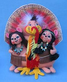 """Annalee Doll Description: Indian mice have tan bodies. Turkey hugs both the Indians. Facial expressions on the mice may vary. 9""""w x 12""""h. Companion is 309806."""