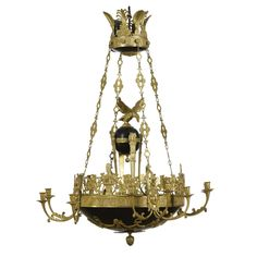 A gilt and patinated bronze twelve-light chandelier, Empire, early 19th century.