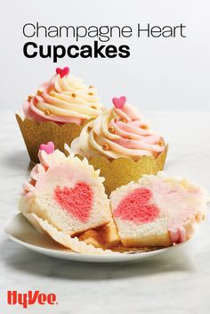 """Your Valentine is going to """"heart"""" this dessert! Surprise them with a homemade cupcake topped with a champagne buttercream frosting. Holiday Desserts, Just Desserts, Holiday Recipes, Delicious Desserts, Yummy Food, Cupcake Recipes, Cupcake Cakes, Dessert Recipes, Sweet Champagne"""
