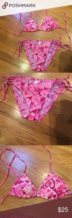 Victoria's Secret bathing suit Victoria's Secret bathing suit. Has padding. Never worn but doesn't have tags. Bottoms are a xs and top is also a xs. Victoria's Secret Swim Bikinis