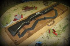 Remington 870 Pump Shot Gun - Gun is a carved half sheet covered in fondant.   Barrel is fondant covered PVC pipe.  Gun case is 3 half sheet BUTTERCREAM cakes.   People kept  touching the case thinking it was not cake! LOL  Had lots of little finger prints on it.  Chocolate cake with turtle filling and chocolate butter cream icing.