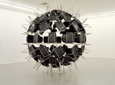 """Black Whole Conference,"" 2006 (72 chairs, 400 cm in diameter)"