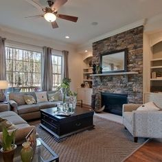 TV/Fireplace Combo with Built-in Bookshelves for the Family Room. I really love that fireplace.