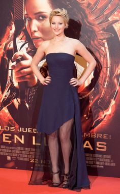 Sheer Beauty from Jennifer Lawrence's Best Looks  Jennifer sports another chic Dior creation at the Madrid premiere for The Hunger Games: Catching Fire, completing the look with Anthony Vaccarello sandals, Ana Khouri black-diamond wing earrings and a Rona Pfeiffer ring.