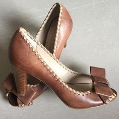 Franco Sarto Brown Leather Pumps size 6 Cute pair of Franco Sarto pums that I don't plan on wearing anymore. Cute bow detail at the vamp. Size 6. New Item. Franco Sarto Shoes Heels