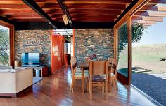 this looks like 2 shipping containers on a large deck,   with an outdoor kitchen under a large shady roof.   I could live here...  out in some beautiful acreage!