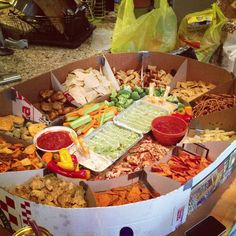Snack-stadium! Great superbowl party or football gathering idea! Constructed using pizza boxes and have each guest bring something!