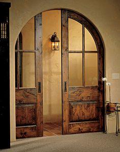 Beautiful arched pocket doors @Wendy Felts Leduc