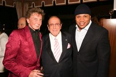 Singer Barry Manilow record company head Clive Davis and rapper LL Cool J.