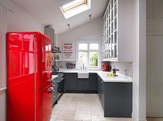 Gorgeous kitchen with gray shelves and a bright pop of red - Decoist
