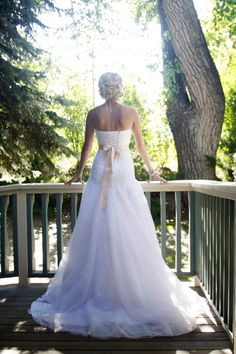 Loved this bride's dress!  She looks beautiful on the porch of the Tapestry House! | Laporte, CO | Photo by Leigh Ray Photography.