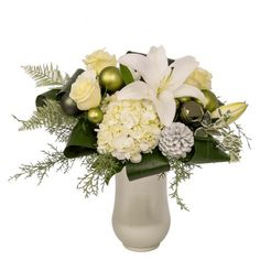 Frosted Glow: An elegant design with white hydrangea, lilies and roses with just the right amount of fancy greens and Christmas accents. Christmas Floral Arrangements, White Lilies, Hydrangea, Frost, Glass Vase, Glow, Lily, Fancy, Elegant