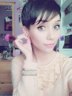 adorable haircut.  super short sides with blended, longer bangs.