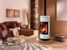 Fortuna - The Fortuna stove is a tall woodburner which you can revolve as needed. Hand enamelled side panels and top give a very stylish finish to the stove and set the cast iron door off very well.