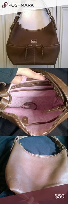 Dooney &  Bourke purse Soft pebbled leather with pink interior. Authentic. Two small pockets in the front great for phones and keys. Bags