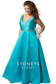 f8ccda7119 Sydneys Closet is a sleeveless Mikado satin plus size prom gown that has a  deep V neckline with illusion net insert