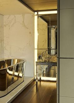 GLAMOUR BATHROOM with a polished nickel tub and a cut crystal sink with MIRRORS + MARBLE!!!