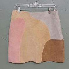 """Groovy suede skirt Beautiful multi-color suede skirt.  Lined.  Side zipper.  17 1/4"""" long.  Excellent condition but it does have one small spot on the back about the size of a head of a pin (see picture) that is barely noticeable. uniform by John Paul Richard  Skirts"""