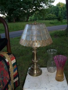 Brass Lamp Shell Shade Tiffany Style Neutral by AntiquesandVaria, $106.20 this is stunning in person...;)  Our etsy shops: http://www.etsy.com/shop/artdesignsbydanielle  http://www.etsy.com/shop/IndustrialPlanet http://www.etsy.com/shop/AntiquesandVaria  http://www.etsy.com/shop/ArtEphemeraButtons  http://www.etsy.com/shop/TheraputicEssentials http://www.etsy.com/shop/AncientHillsWood
