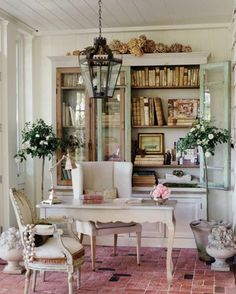 brick flooring for sunroom/study + china cabinet with books in it.