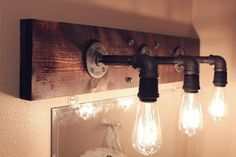 Cool idea for a bathroom vanity lighting fixture blending rustic wood with industrial pipe and vintage edison bulbs Bath and Kitchen Fixtures Rustic-luxe bathroom design at La Granja Ibiza, a Design Hotels retreat on a century finca Industrial Bathroom Lighting, Vintage Industrial Lighting, Industrial Pipe, Rustic Lighting, Bathroom Vanity Lighting, Lighting Ideas, Industrial Style, Club Lighting, Industrial Furniture