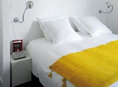 bedrooms-white-yellow-bedspreads-hotels-side-tables-wall-lights