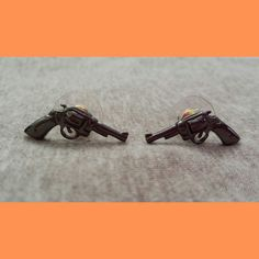 Which color of gun earrings do you prefer? Gold plated or Rhodium Plated?