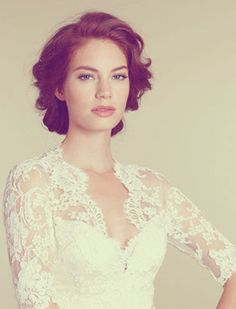 BRIDAL HAIRSTYLE FOR SHORT HAIR-I like how it's curly but still away from her face. more wavy, i guess.
