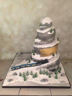 Polar express train on the mountain birthday cake