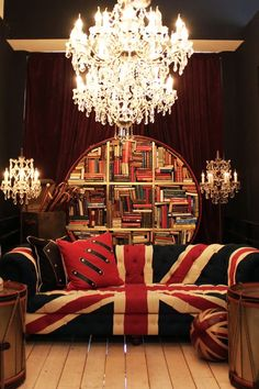 Wonderful chic for our  british friends using the union jack as this sofas material love the rounded bookcase and of course the bling chandeliers perfect for the a british citizen relocating