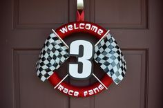DIY welcome wreath for race car/Lightning McQueen birthday party.